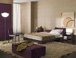 Изработка на тапицирана спалня по поръчка с облицовка от лилав велур и мека табла
